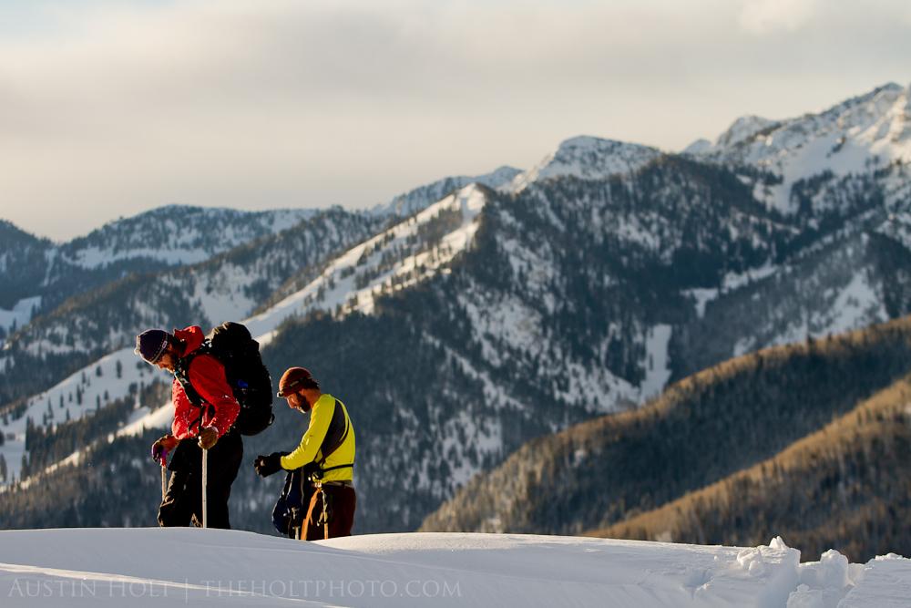 Two skiers preparing to ski powder in the mountains of Utah.