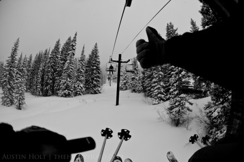 Sitting on the lift and giving a thumbs up on a deep powder day at Solitude