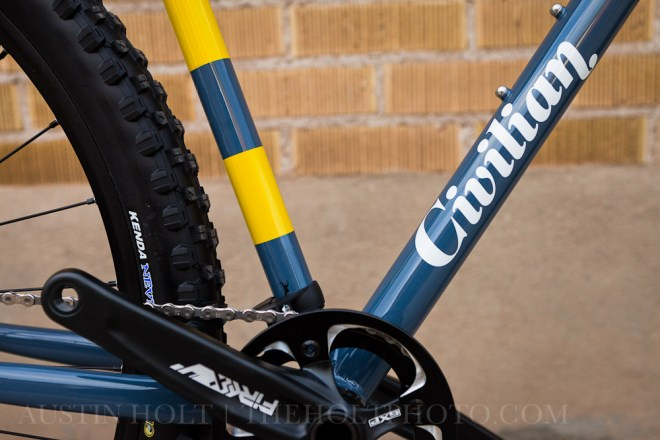 A photograph of the Civilian Bikes logo printed on the frame of a Young Turk 29er mountain bike frame