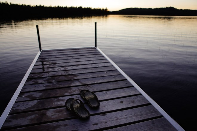 Sandals on a Dock at Hancock Pond in Sebago, Maine