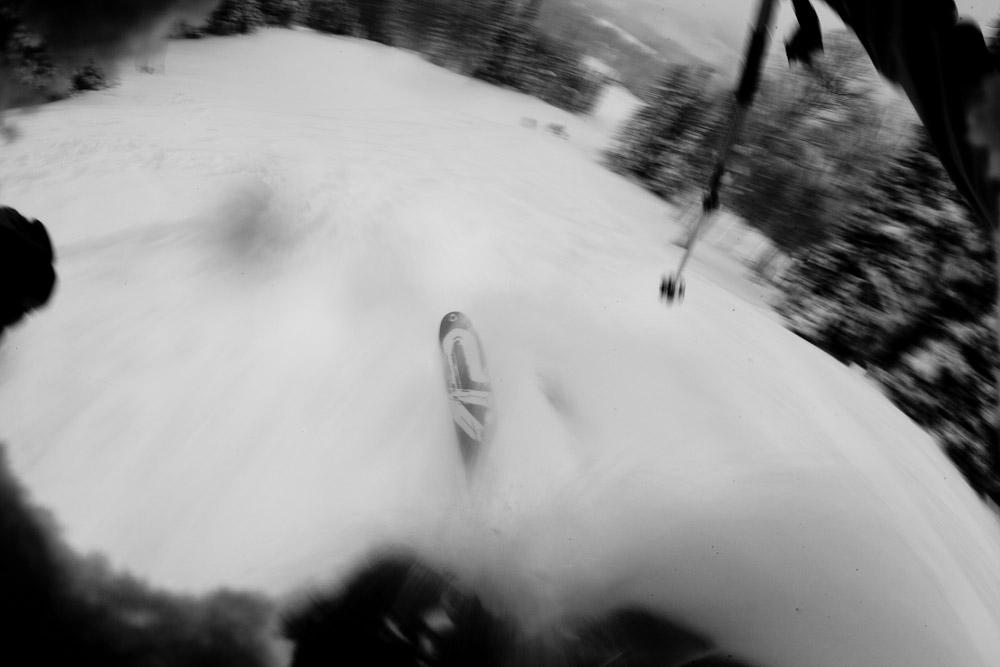 A POV photograph of skiing powder at Brighton Ski Resort in Utah.