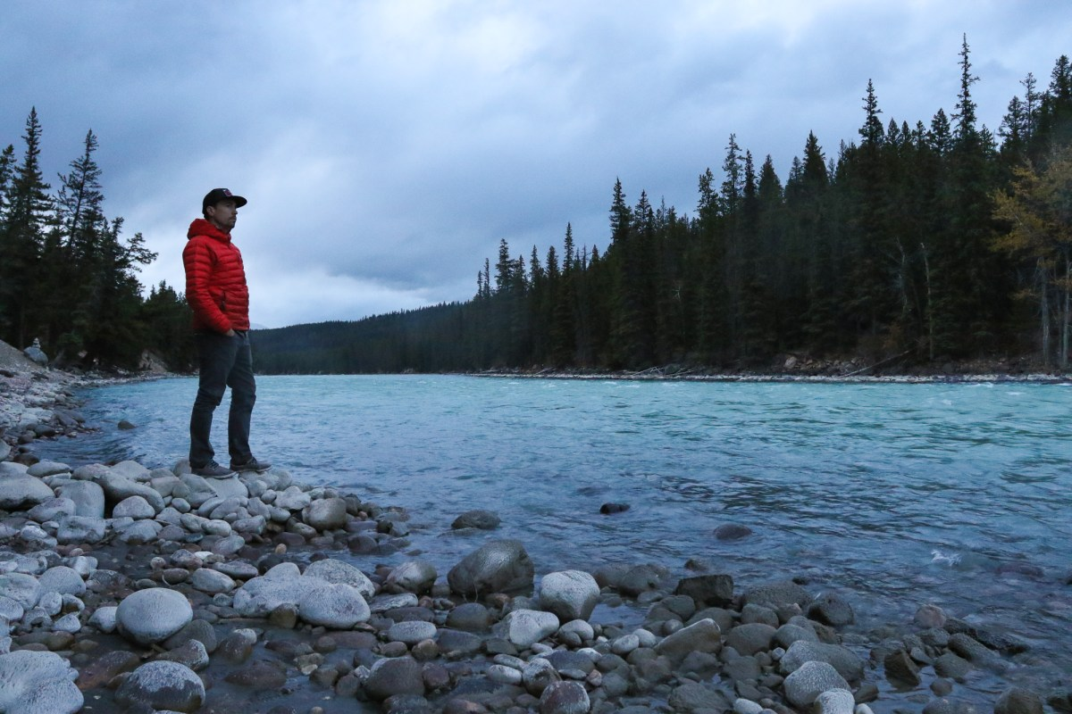 Standing by the river at a campground in Jasper, Alberta.
