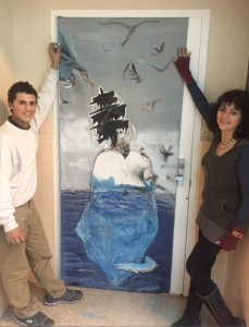 AP art student Steven Banegas Ayarra and art teacher Charlie Milgrim outside her door. Photo courtesy of Charlie Milgrim