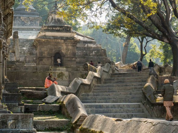 A flute player on the steps leading to the upper temples