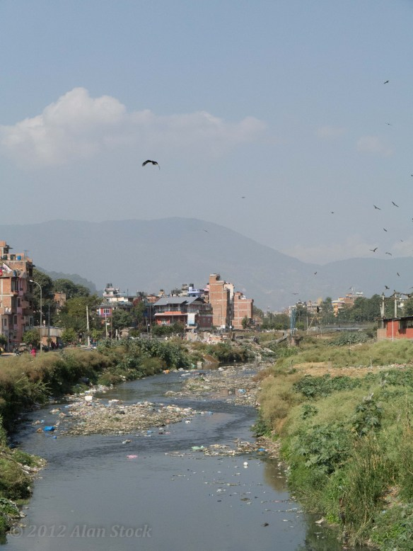 The dirty river in Kathmandu, with birds of prey circling overhead