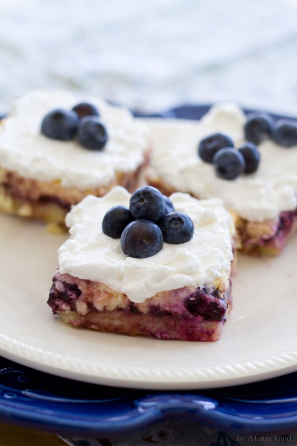 On a lemon shortbread crust, these lemon blueberry cheesecake bars are the perfect summertime dessert! So good you'll be coming back for