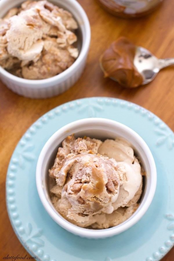 This homemade ice cream is filled with cinnamon crunch bits and swirled with dulce de leche! It's like eating a churro in ice cream form.