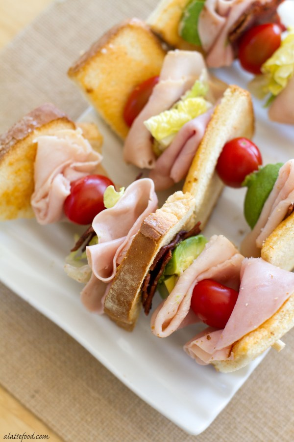 These deconstructed turkey club sandwiches are packed with the works: turkey, bacon, avocado, cheese, tomatoes, and toasted bread!    www.alattefood.com