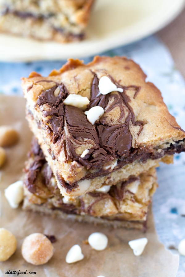 These gooey Nutella bars are the life of the party. With all of the white chocolate chips, macadamia nuts, and swirls of Nutella, how could they not be?