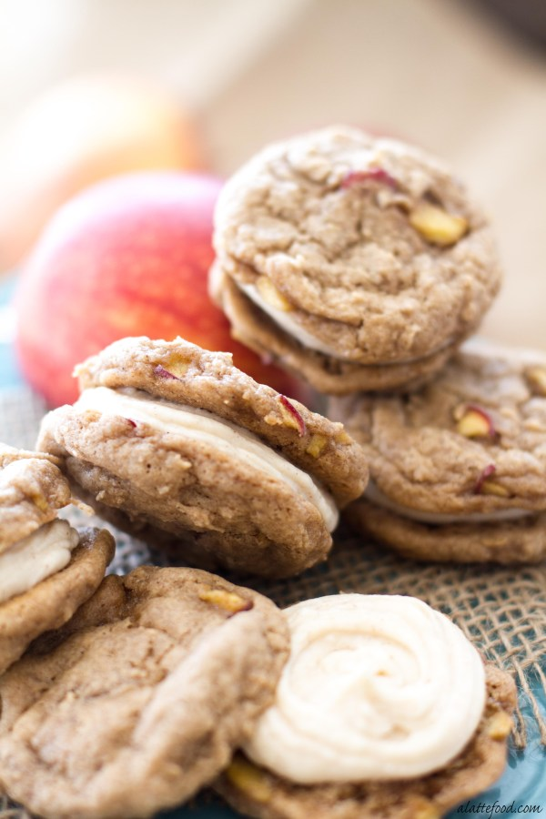 These whoopie pies are filled with cinnamon spice and baked apples, and have a rich, cinnamon cream cheese filling. They're soft, sweet, and taste like fall!