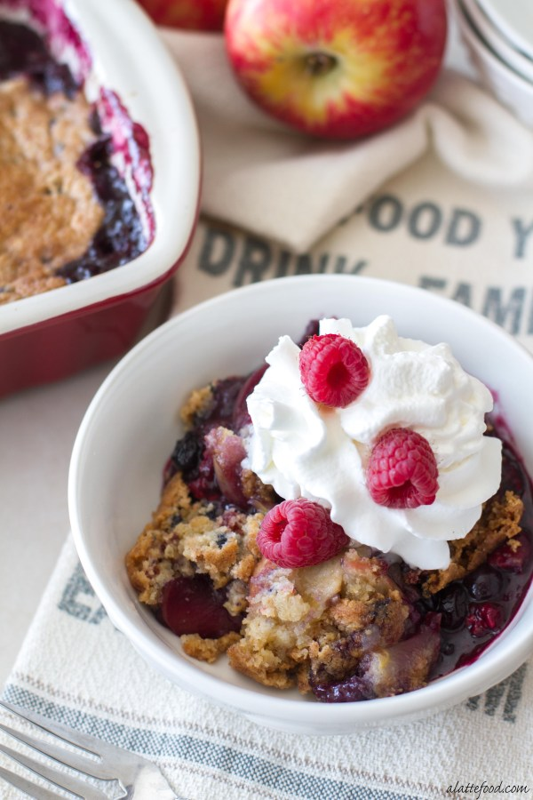 This easy cobbler recipe is full of juicy apples, mixed berries, and topped with a sweet and simple cobbler muffin mix topping!
