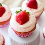 These homemade strawberry cupcakes are filled with homemade whipped cream and topped with fresh strawberry frosting! They are bright pink and the perfect recipe for Valentine's Day, spring, and summer!