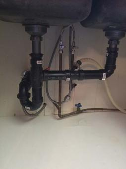 plumbing underneath the sink in kitchen