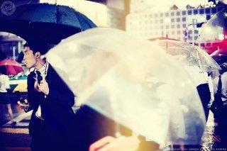 Smoking salaryman and umbrellas at Shibuya Crossing