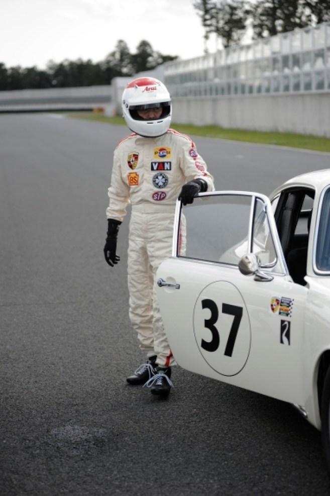 Tetsu Ikuzawa emerges from his car after winning the race