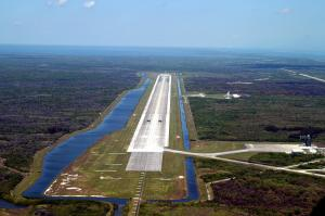 The runway at Kennedy's Shuttle Landing Facility is longer and wider than most commercial runways - 15,000 feet long, with 1,000-foot paved overruns on each end, and 300 feet wide, with 50-foot asphalt shoulders.