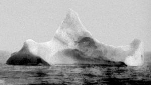 This iceberg was possibly the one that sunk the RMS Titanic; a smudge of red paint much like the Titanic's red hull stripe was seen near its base at the waterline. Public domain image.