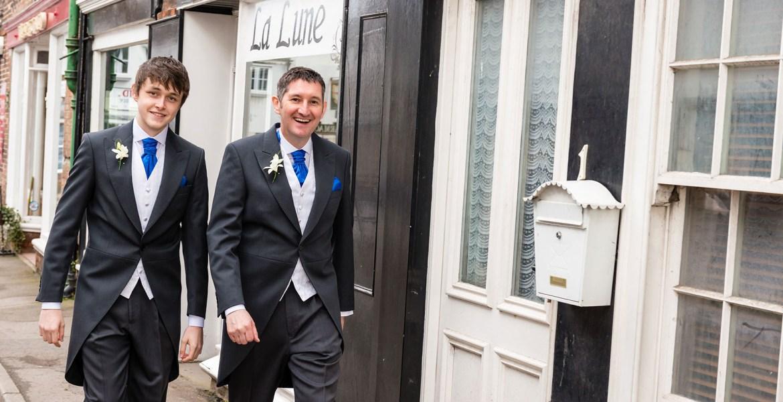 Documentary wedding photographer walk to the church