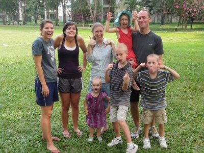 """Our family and two of """"our girls,"""" at some of the only green space in the city."""