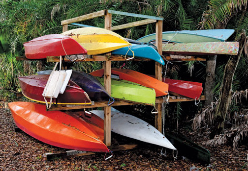In search of the Perfect Boat - A rack of various kayaks built and used by the crew at Lucas Boat Works.