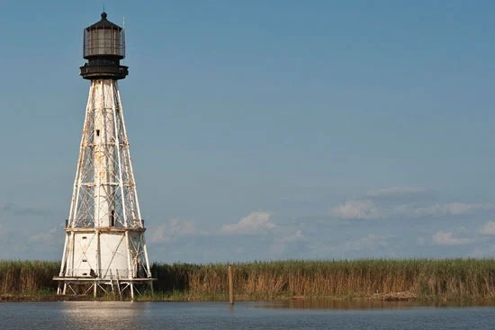 The 1881 South Pass lighthouse overlooks the site of the new Port Eads Marina. PHOTO: Rush Jagoe  /  www.louisianaseafoodnews.com