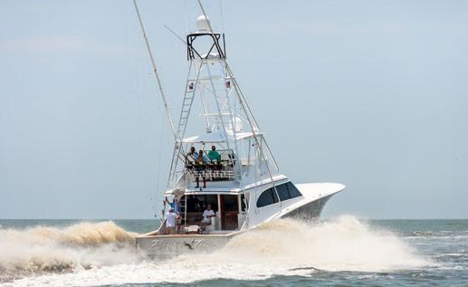 Gufl Coast Billfish Classic - 2012 winner Birdie Time heads offshore. Photo by Alaric Lambert