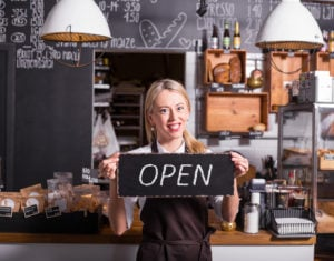 Woman promoting newly opened coffee shop