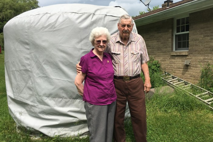 Shirley and Bill Eakin of Washington County stand in front of a 2,500-gallon tank that holds their home's water supply. The couple hasn't used their well water for drinking since 2009, after they experienced water issues they attribute to nearby drilling operations. The Eakins, who live on just $27,000 a year, now buy their own water and receive donated bottled water. Photo: Marie Cusick / StateImpact Pennsylvania