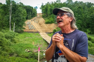 Farmer Mick Luber stands along the southern border of his property in eastern Ohio, where Marathon has begun installing a liquid natural gas pipeline. Luber was able to reach an agreement with another company to reroute its proposed pipeline around his farm. Photo: Julie Grant