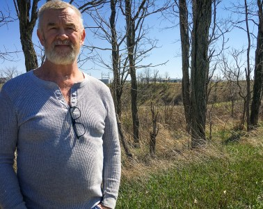 Carroll County resident Barry Booth stands near his home, which is within sight of a natural gas compressor station. He believes emissions from the facility have contributed to his family's health problems, including nausea, rashes, nosebleeds, headaches and his wife's breast cancer. Photo: Joanna Richards