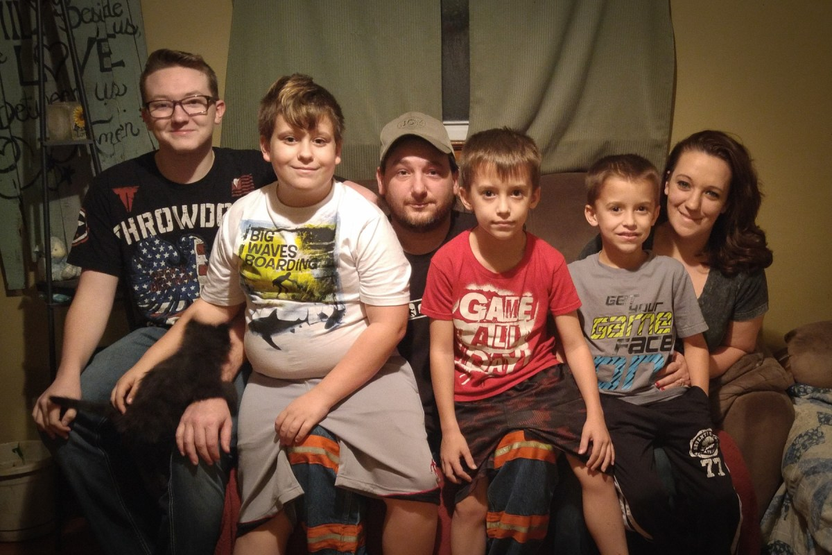 Coal miner Mackie Branham, Jr. and his family. Photo: Benny Becker / Ohio Valley Resource