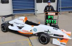 Chris Middlehurst stands by his Championship winning 2013 Protyre Formula Renault car with a P1pit board
