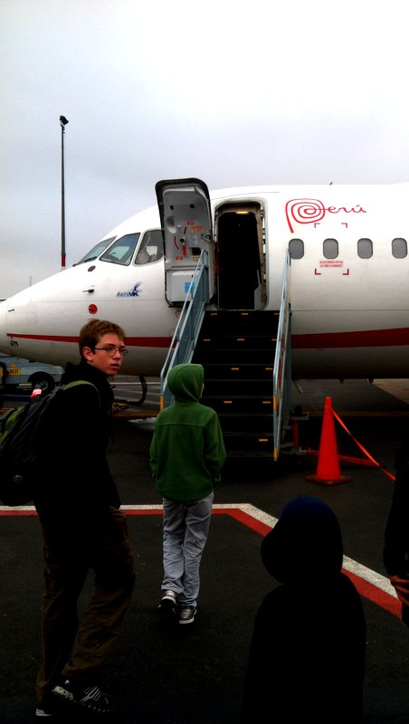 Children boarding a plane from Lima to Cusco, Peru