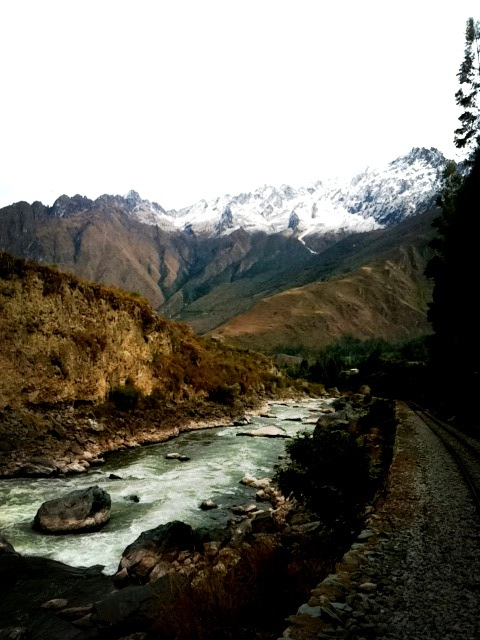 Mountain and river views from the Sacred Valley train, Peru