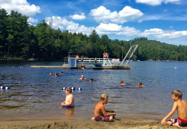 The public beach at Long Lake, NY is less than two miles from John Dillon Park.