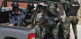 Mexican marines escort two arrested men, at a naval base in Salina Cruz