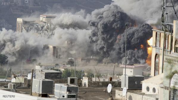 Smoke billows during an air strike on the Republican Palace in Yemen's southwestern city of Taiz