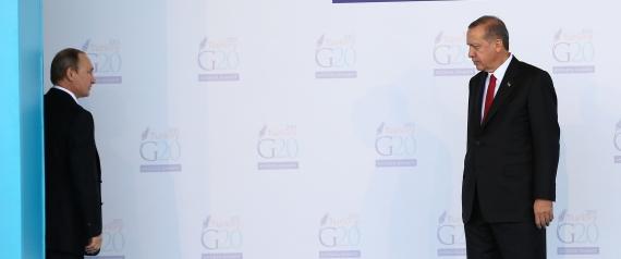 ANTALYA, TURKEY - NOVEMBER 15 : Turkish President Recep Tayyip Erdogan (R) talks with Russian President Vladimir Putin (L) during the 'Welcoming Ceremony' prior to the G20 Turkey Leaders Summit on November 15, 2015 in Antalya, Turkey. (Photo by Turkish Presidency / Yasin Bulbul/Anadolu Agency/Getty Images)