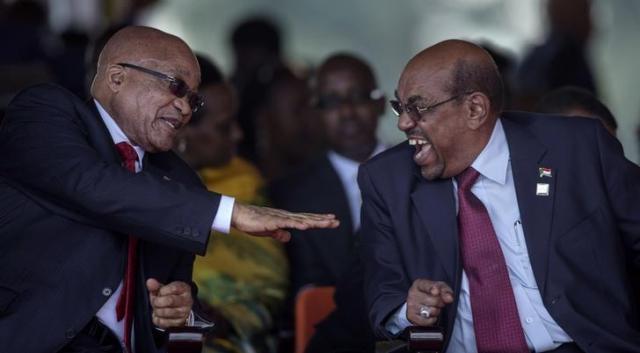 البشير يضحك في اوغندا