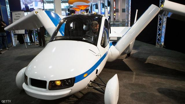 NEW YORK, NY - APRIL 05:  The Terrafugia Transition is introduced at the 2012 New York International Auto Show on April 5, 2012 in New York City. The Transition is the first of its kind: it is simultaneously able to perform as an aircraft or a street-legal vehicle. The New York International Auto Show features nearly 1,000 brand new vehicles from all auto industry sectors and is open to the public April 6-15.  (Photo by Andrew Burton/Getty Images)
