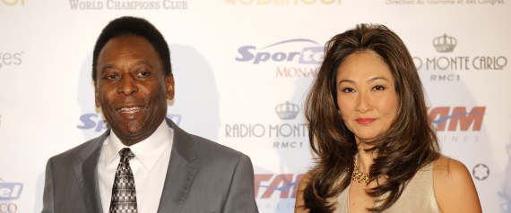 "Brazilian former soccer player Edison Arantes do Nascimento, better known as Pele and his girlfriend, arrive at the ceremony of the ""Golden Foot 2012"" awards, in Monaco, Wednesday, Oct. 17, 2012. Pele will be awarded during the ceremony. (AP Photo/Lionel Cironneau)"