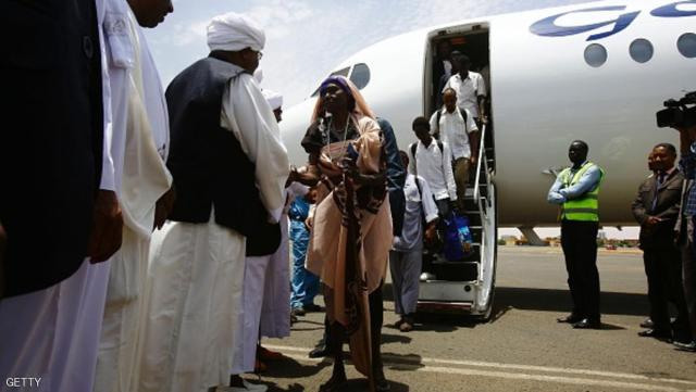 An elderly Sudanese woman is assisted as she disembarks a plane after arriving at the airport in Khartoum from Juba on July 15, 2016 as Sudan began evacuating its nationals from South Sudan, following fresh fighting in the South Sudanese capital ahead of the country's independence anniversary.The last in the city of Juba Sunday noon July 15, 2016 South Sudanese voted for independence from Sudan under a peace agreement in 2011 but the world's youngest country fell into a civil war that has killed tens of thousands of people. Specially chartered planes have been taking foreign nationals out of the country since July 13. Sudan too began evacuating its nationals, and the first flight carrying 76 Sudanese arrived in Khartoum on July 15./ AFP / ASHRAF SHAZLY        (Photo credit should read ASHRAF SHAZLY/AFP/Getty Images)