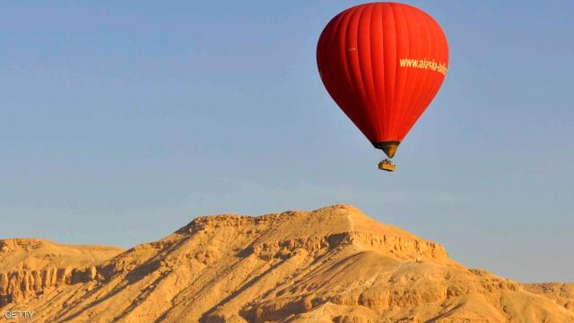 A hot air balloon flies over Luxor on April 21, 2013 as balloon flights resumed nearly two months after a deadly accident killed 19 tourists. Four flights took off from the ancient temple city, with around 70 tourists on board, said Ahmed Abboud who heads the Balloon Flights union.  AFP PHOTO / STR        (Photo credit should read -/AFP/Getty Images)