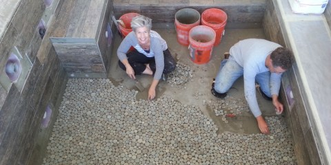Luke and Amy setting pebbles by hand.