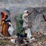 Pakistani scavengers search for items to