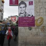 A banner depicting Mohammed Assaf, a contestant in Arab Idol, is seen on a building in the West Bank city of Ramallah