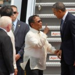 Philippine's Vice President Binay gestures as he welcomes U.S. President Obama upon his arrival at an airport in Manila