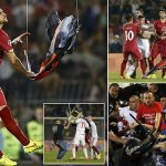 Mitrovic of Serbia grabs an Albanian flag that was flown over the pitch during their Euro 2016 Group I qualifying soccer match against Albania at the FK Partizan stadium in Belgrade