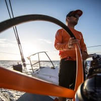AT SEA - NOVEMBER: In this handout image provided by the Volvo Ocean Race, onboard Team Alvimedica. Alvimedica resumes racing after being released from standby at the Cargados Carjos Shoals where Team Vestas had run aground and abandoned ship. Ryan Houston on the helm in his Texas Houstons game day hat during Leg 2 between Cape Town, South Africa and Abu Dhabi, UAE. The Volvo Ocean Race 2014-15 is the 12th running of this ocean marathon. Starting from Alicante in Spain on October 11, 2014, the route, spanning some 39,379 nautical miles, visits 11 ports in 11 countries (Spain, South Africa, United Arab Emirates, China, New Zealand, Brazil, United States, Portugal, France, the Netherlands and Sweden) over nine months. The Volvo Ocean Race is the world's premier ocean race for professional racing crews. (Photo by Amory Ross/Team Alvimedica/Volvo Ocean Race via Getty Images)