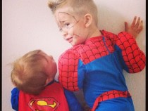 Brothers dressed as superheros
